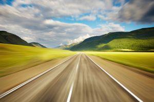 motion blur clouds hills landscape road