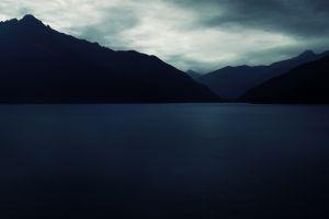 mountains clouds mountains dark lake