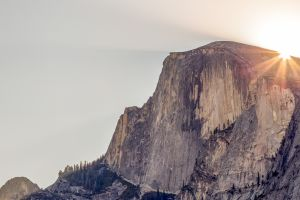 mountains sun rays sunset rocks