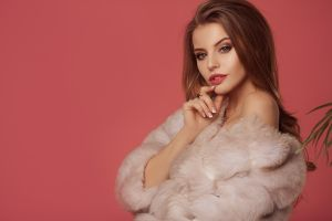 necklace brunette pink background juicy lips women indoors fur coats coats simple background fur looking at viewer portrait bare shoulders glamour women glamour long hair
