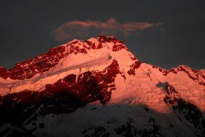 new zealand snowy peak nature sunlight snow peak dark mountains