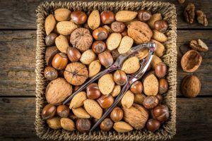 nuts hazelnut baskets food wooden surface walnuts