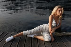 outdoors women dock portrait blonde ropes adidas cleavage model sensual gaze sneakers water jumpsuit women outdoors looking at viewer