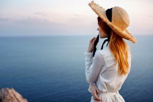 outdoors women outdoors model redhead depth of field sea sky back straw hat looking into the distance white dress georgy chernyadyev horizon women with hats women
