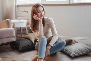 pillow model barefoot sergey freyer sitting polina kostyuk straight hair sweater looking away women brunette blue eyes jeans