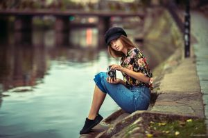 pink lipstick sitting sneakers denim camera women méline borrajo portrait river lods franck