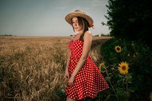 plants field outdoors sunflowers women with hats portrait brunette women outdoors flowers women straw hat bokeh depth of field dress model