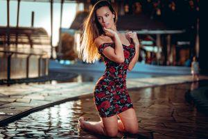 portrait brunette barefoot women tight dress hand on face pearl earrings touching face kneeling in water marco squassina dress