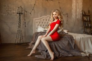 portrait brunette bed women sitting pillow blonde red dress