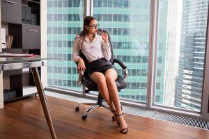 portrait brunette office sitting heels glasses pen in mouth legs building painted nails leather skirts miniskirt women indoors women model