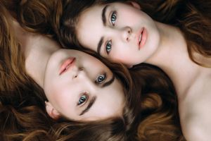 portrait brunette top view sisters two women face women looking at viewer twins model