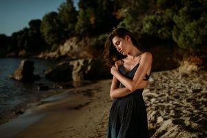 portrait closed eyes pink nails black dress sand women arms crossed bare shoulders eyeliner sea women outdoors