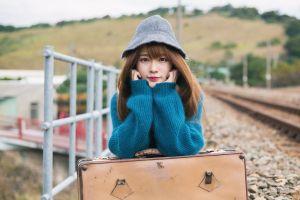 portrait depth of field women asian sweater looking at viewer women outdoors bag women with hats railway model brunette