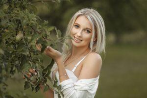 portrait smiling women blonde women outdoors model