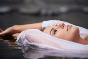 portrait wet model wet clothing women long eyelashes closeup photography in water arms up water