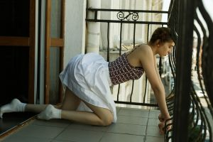 profile socks kneeling hairbun side view white skirt brunette crop top skirt balcony women model