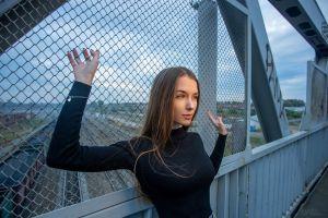 railway sky sweater bridge portrait black sweater women outdoors model women horizon long hair outdoors looking away brunette