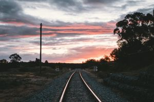 railway sunset sky pebbles railroad track