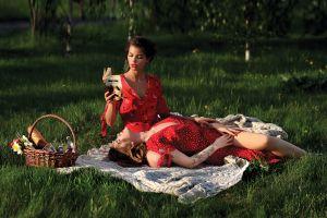 reading brunette red dress grass model lying on back tattoo cleavage women women outdoors inked girls dress picnic closed eyes portrait