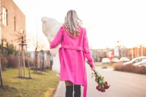 rear view women roses blonde pink clothing pink coat open coat teddy bears model coats street women outdoors public knee-high boots