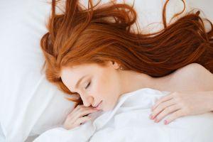 redhead model in bed women closed eyes long hair