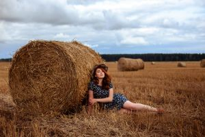 redhead on the floor hay depth of field women outdoors model women dress looking at viewer women with hats
