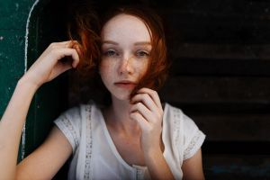 redhead outdoors women outdoors women hair in face model blouses depth of field fair skin aleks five hands portrait freckles looking at viewer touching hair