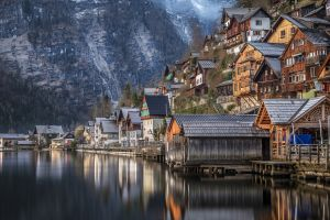 reflection house austria mountains village mountain pass water hallstatt lake snow