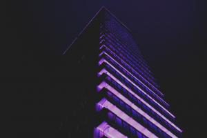 retro style night city purple night sky skyscraper