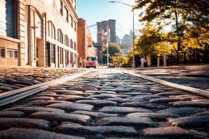 road city new york city railway street brooklyn bridge stones pavements sunlight worm's eye view cobblestone