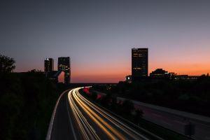 road sunset light trails lights city