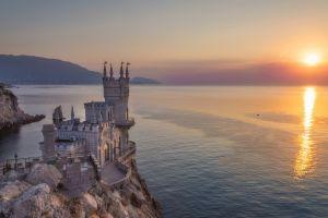 sea sun black sea castle landscape tower reflection mountains crimea architecture ancient nature cliff