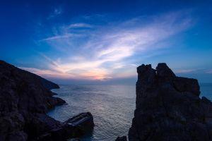 sea water horizon cliff rocks blue