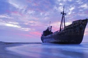 shipwreck sea clouds shore horizon violet