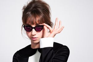 simple background women with glasses women actress zoe kazan