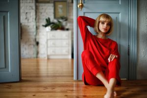 sitting blonde arms up blue eyes women indoors women model red sweater