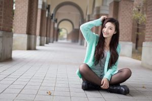 sitting photography urban arms up smiling asian women outdoors women model looking at viewer legs crossed long hair