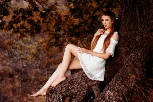 sitting white dress touching hair women pierced ear elves portrait model trees women outdoors looking at viewer barefoot