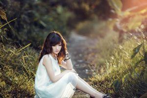 sitting women outdoors nature white dress model women asian long hair plants brunette photography