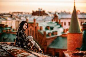 sitting women outdoors women model looking at viewer rooftops coats