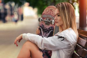 skateboard white jacket portrait outdoors jacket looking into the distance model tattoo women outdoors depth of field bokeh street sitting bench women