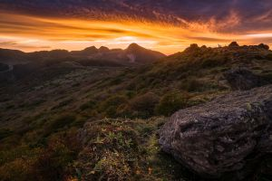 sky landscape dark rocks sunlight mountains