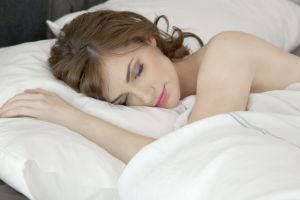 sleeping model makeup in bed closed eyes in bedroom closeup photography women pink lipstick