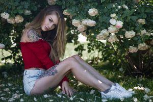 sneakers portrait brunette rose piercing grass nike tattoo women outdoors jean shorts sitting bare shoulders flowers socks women
