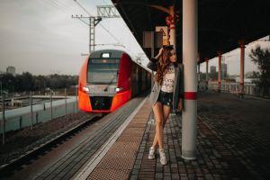 sneakers train station tanned train portrait railway station women jean shorts