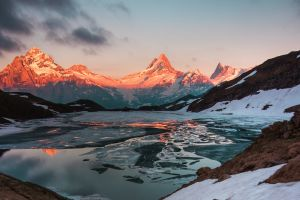 snow sunset ice switzerland lake mountains