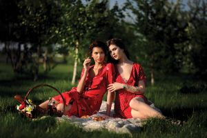 stretched ears baskets inked girls looking at viewer dress sitting model two women picnic outdoors grass cleavage red dress women women outdoors