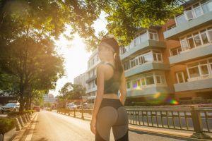 sun rays women yoga pants ponytail sportswear fitness model brunette leggings 500px model