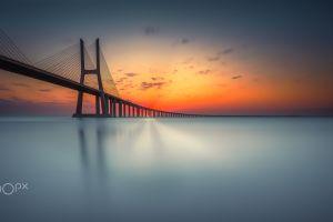 sunset bridge nature architecture 500px sun rays sky water reflection