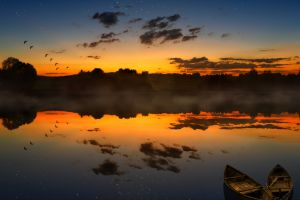 sunset dark nature clouds sky sunlight boat horizon reflection lake